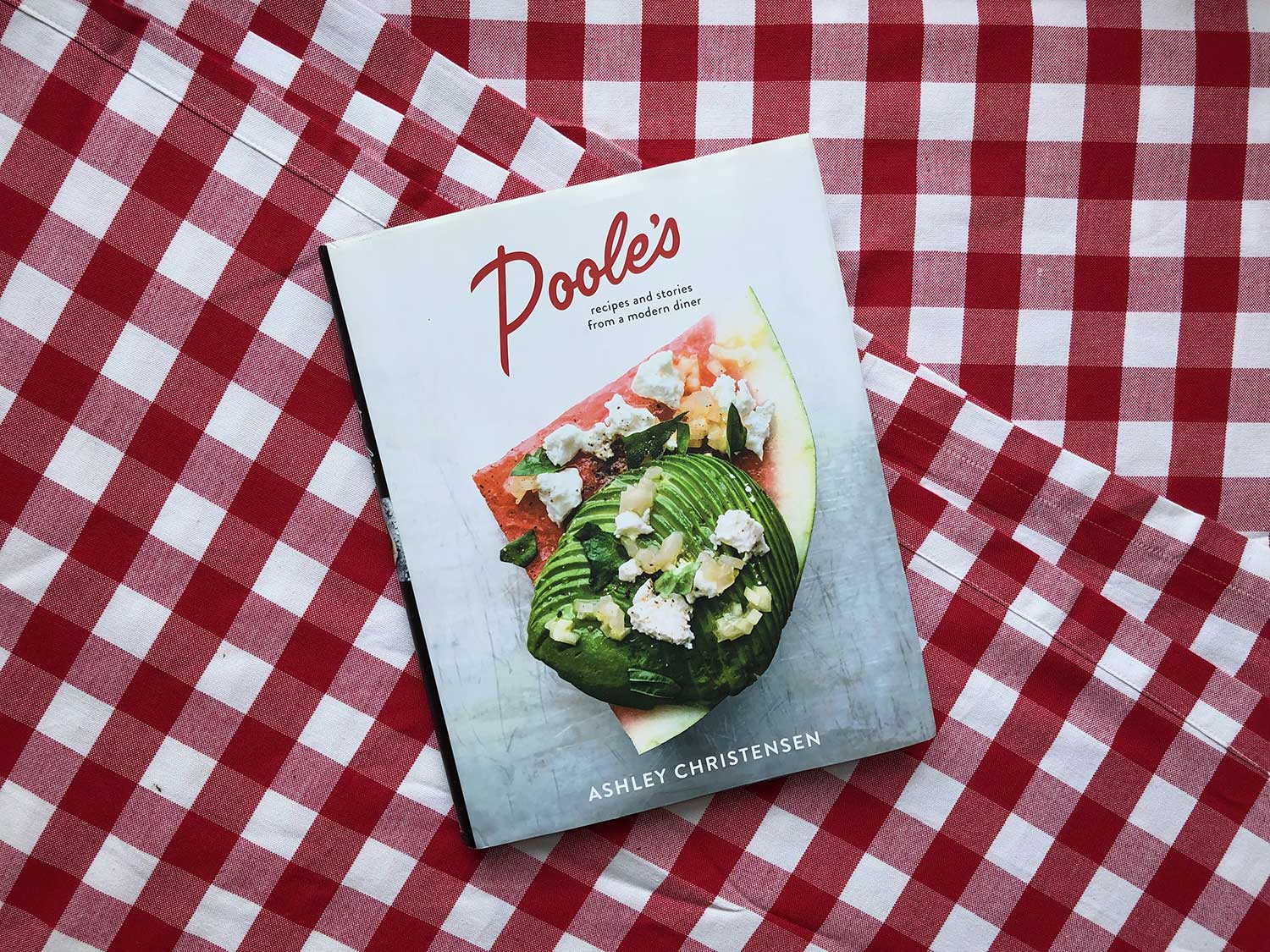 Transport Yourself to Poole's with This Month's Cookbook Club Pick