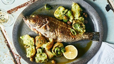 Whole Roasted Black Bass with Potatoes, Green Olives, and Salsa Verde