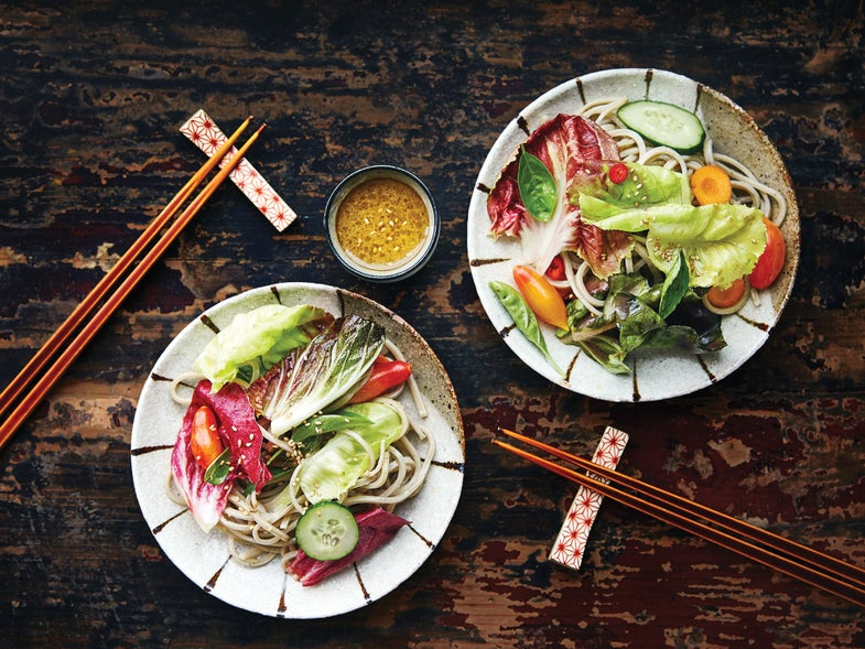 Soba salad recipe with summer greens on two plates