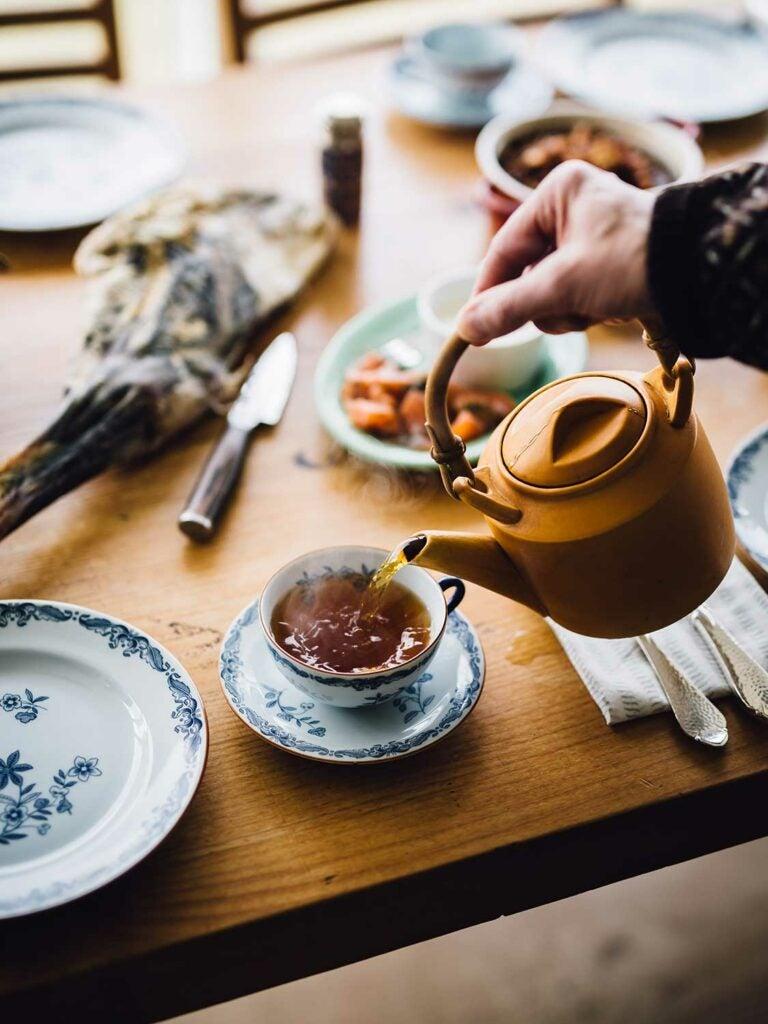 Óli Rubeksen serves tea