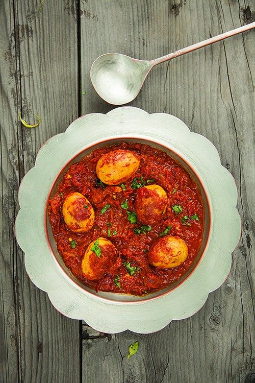 Fried Hard-Boiled Eggs with Oven-Dried Tomatoes (Zoomru Tool and Ruwangan Hach)