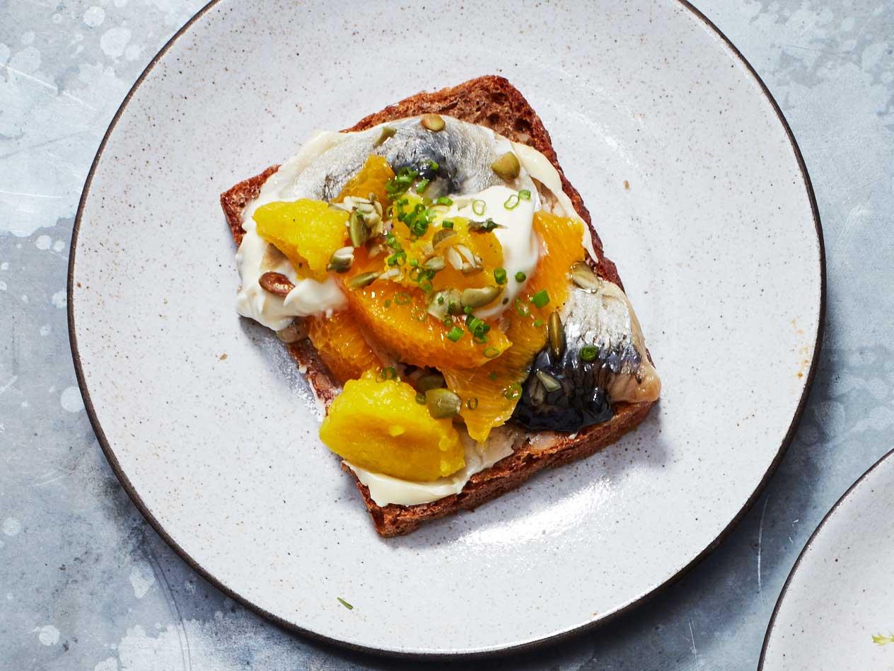 Copenhagen, Smorrebrod, Pickled herring, oranges, creme fraiche