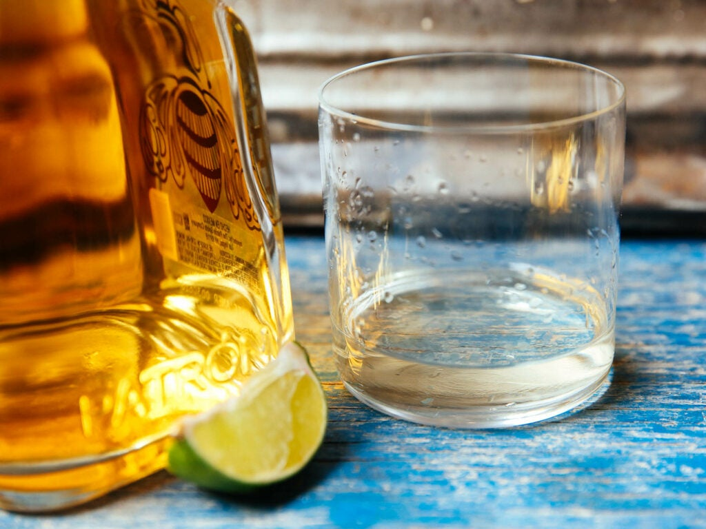 Tequila in a glass with lime