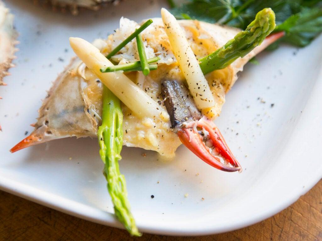 scrambled eggs and asparagus stuffed in crab shells