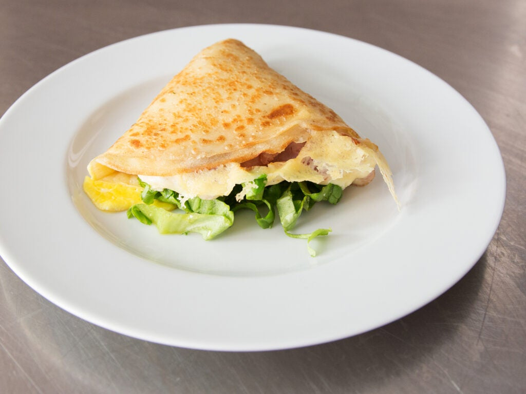 ham and cheese crêpe on white plate