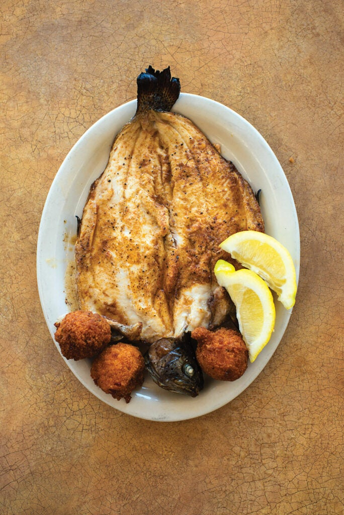 httpswww.saveur.comsitessaveur.comfilesimport2013images2013-077-recieps_broiled-rainbow-trout-with-hush-puppies_1000x1500.jpg