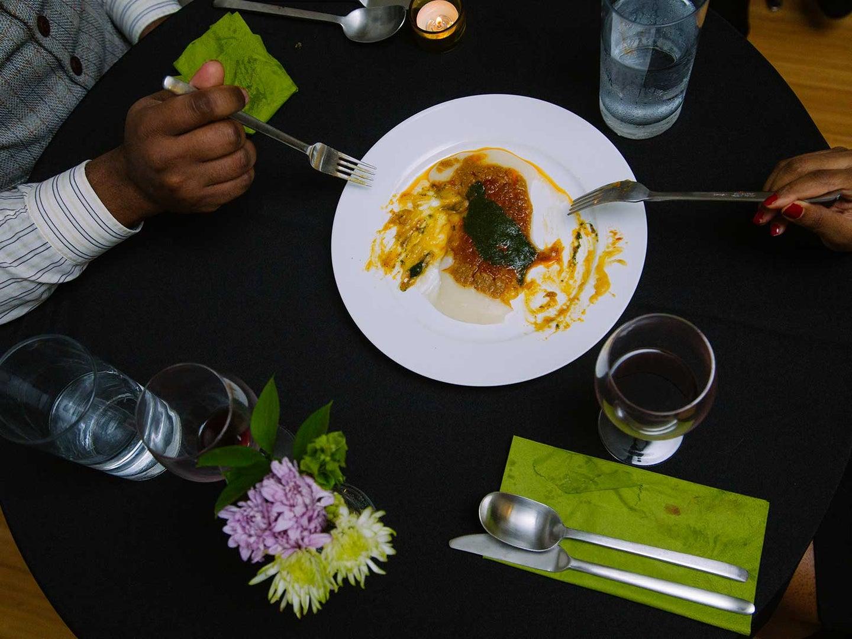 Diners sharing fufu dish