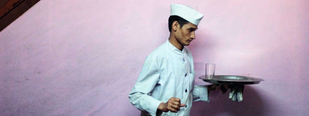 waiter at the Indian Coffee House