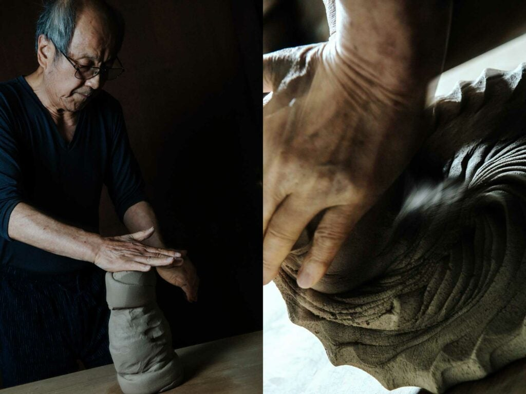 Kimura works mounds of clay