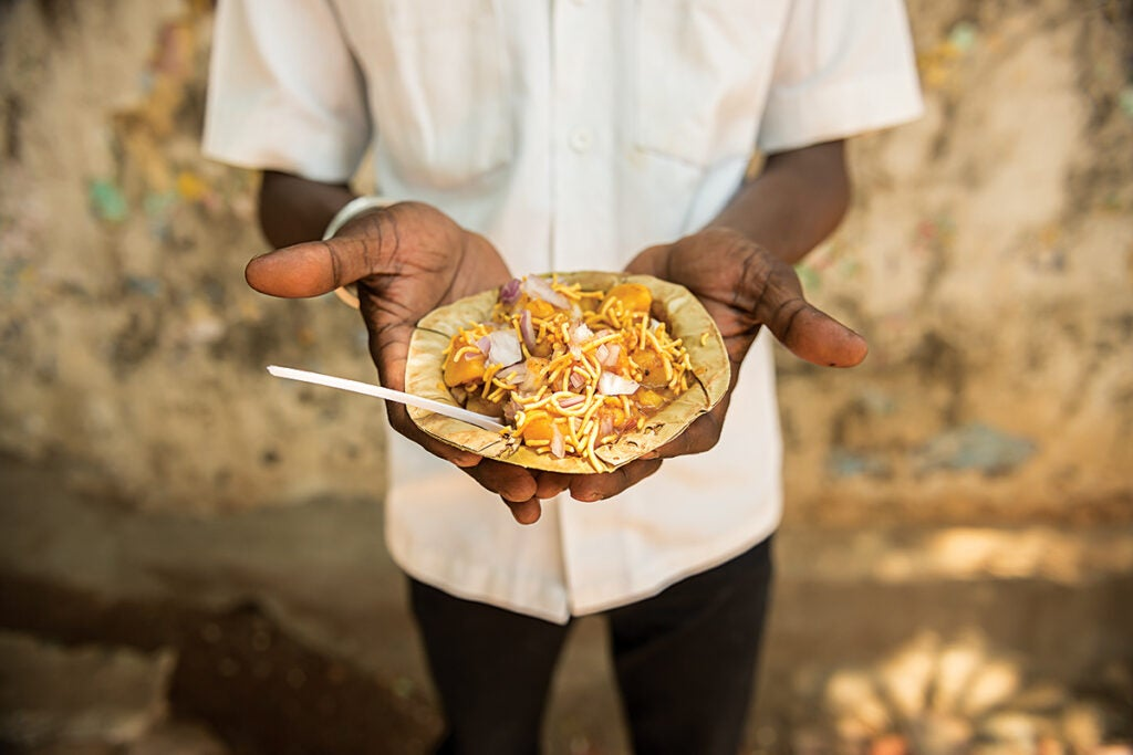 Man Holding Aloo Chana Chaat