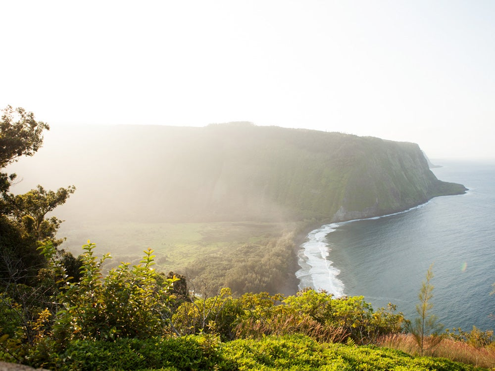 The valley's black sand beach is visible from Waipi'o Overlook