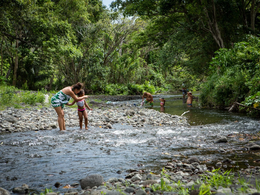 Mock Chew family members cool off in one the streams flowing through Waipi'o Valley
