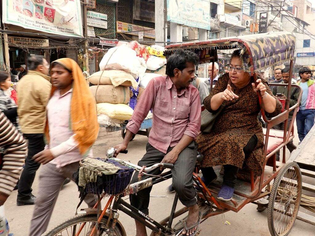 Reshii in a pedal rickshaw