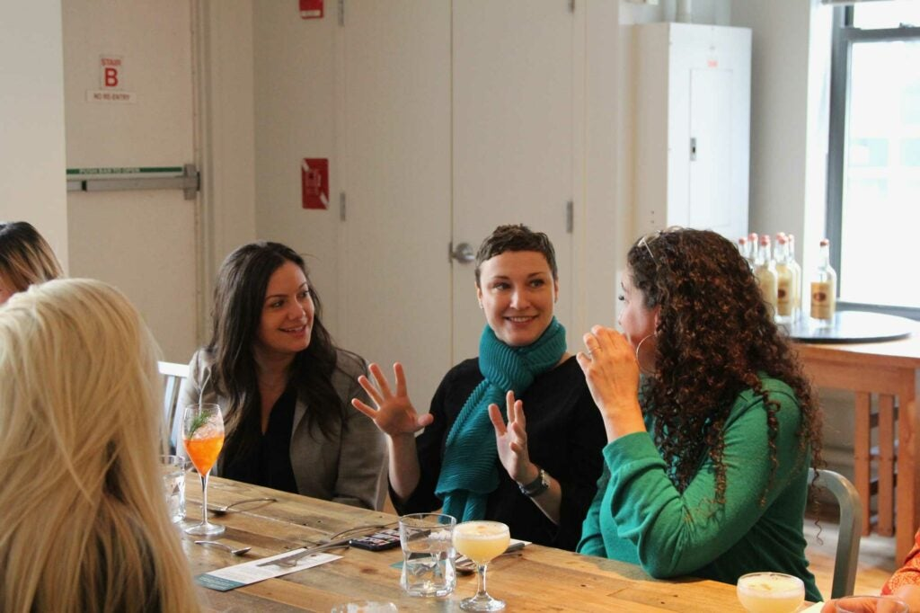 From left, Juliana Pesavento and writers Kristin Vukovic and Kate Heddings take a break from martinis to chat.