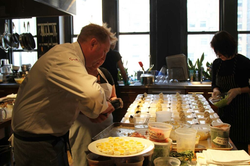 Commander's Palace head chef Tory McPhail piles caviar on top of seafood sandwiches for the first course.