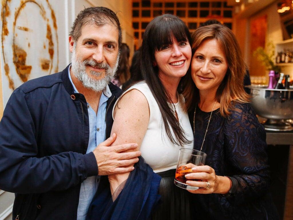 Writer Brett Moskowitz and SAVEUR publicists Stefanie McNamara and Perri Dorset lean in for a group shot at Fusco.