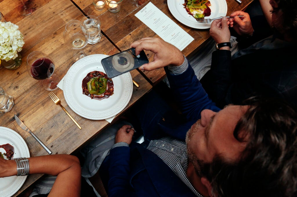 Editor in Chief Adam Sachs sneaks an overhead food shot during dinner.