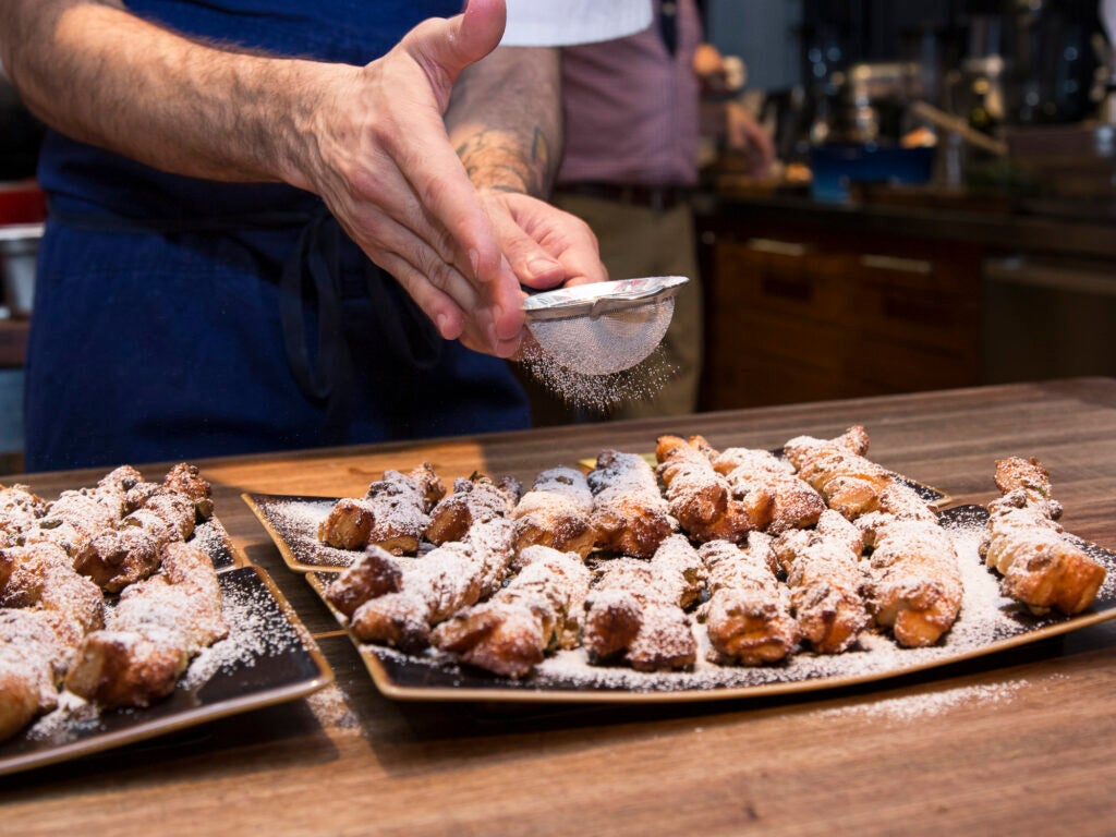 These pistachio sacristains get a healthy sprinkling of powdered sugar
