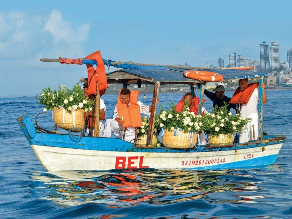 boat bearing floral tributes to sea-goddess Iemanjá