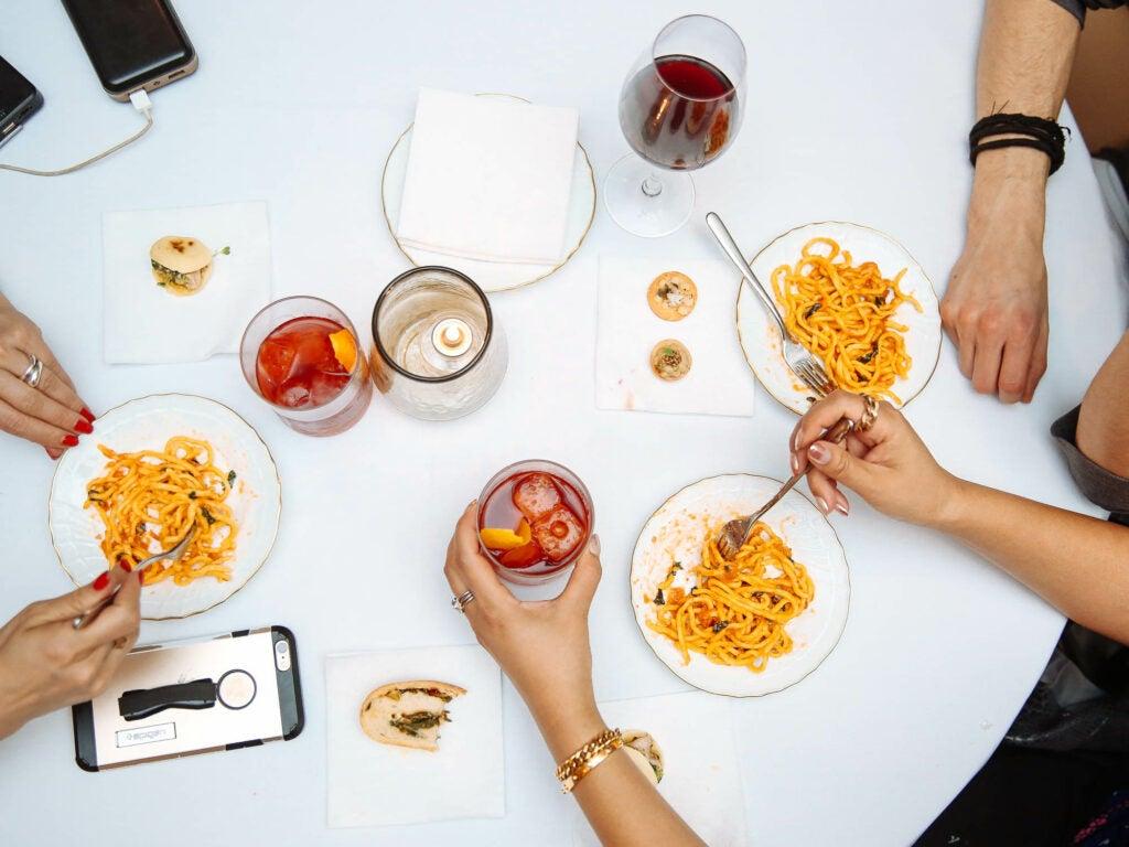 Chef Scott Conant's spaghetti pomodoro looks excellent beside some Boulevardiers.
