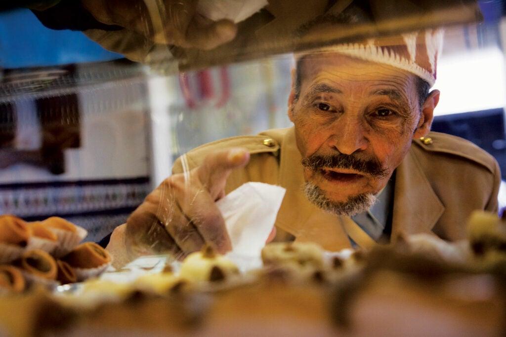 A customer at El Andalousia, an Algerian pastry shop.