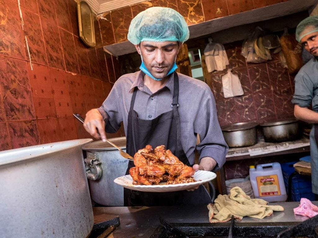 At Taj Mahal restaurant, whole chickens are coated in a proprietary spice rub before they're deep-fried to a crisp.