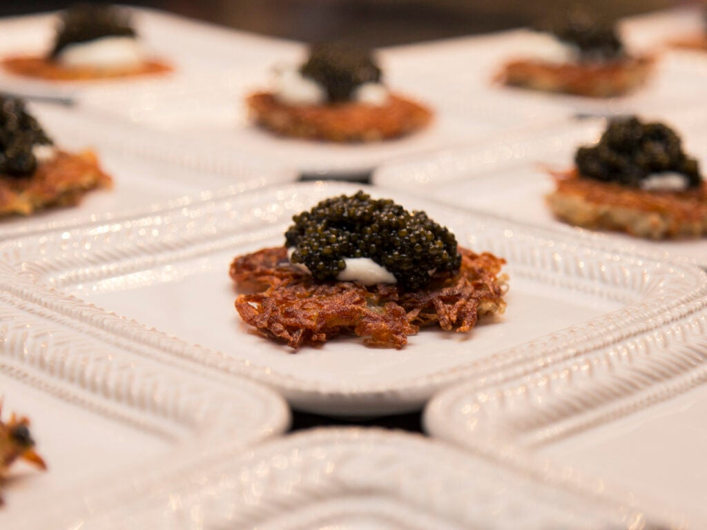 Potato cakes, caviar, and creme fraiche