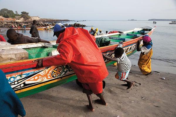 A fishing boat comes ashore at Soumbedioune
