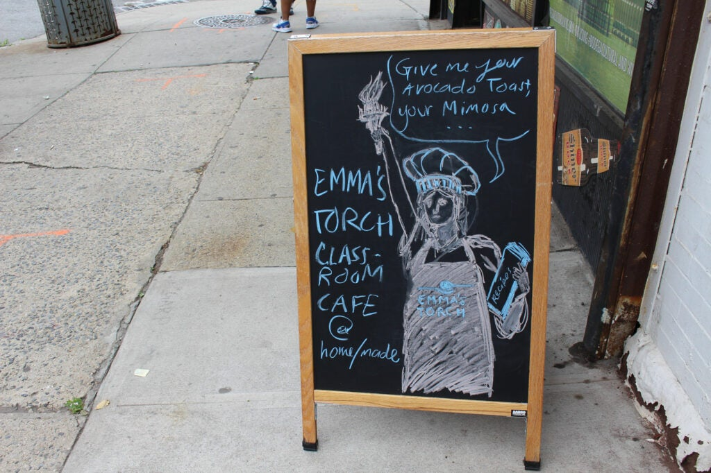 A sign outside Emma's Torch.