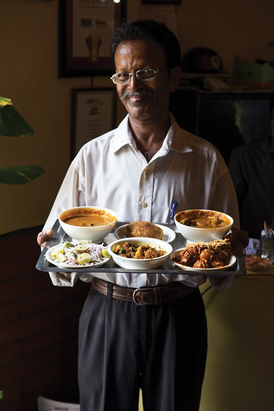 feature_west-india_mumbai_bombay-ideal_man-with-food_533x800.jpg