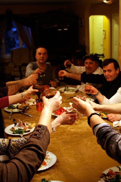 people toasting around a table