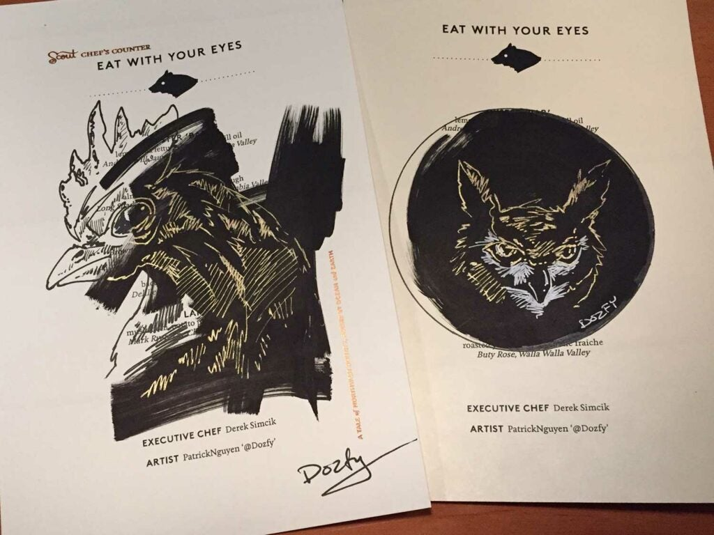 Black, white, and gold drawings of a rooster and owl
