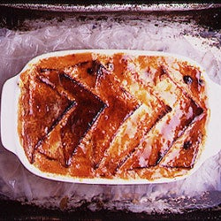 Bread and Butter Pudding Served with Clotted Cream and Compote of Apricots
