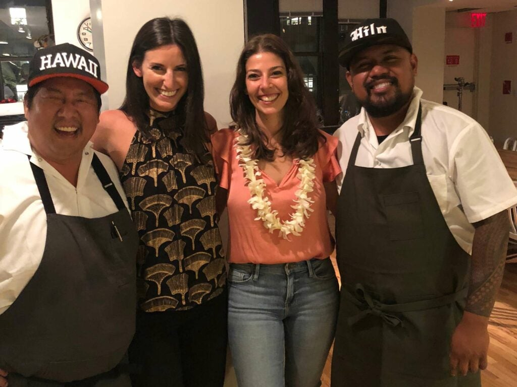 two women and the chefs at SAVEUR test kitchen supper