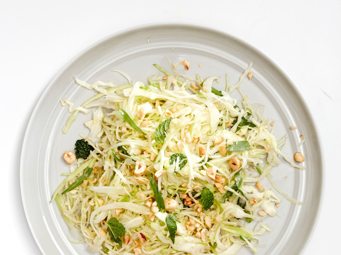 Green Cabbage Salad with Charred Cabbage Vinaigrette and Hazelnuts