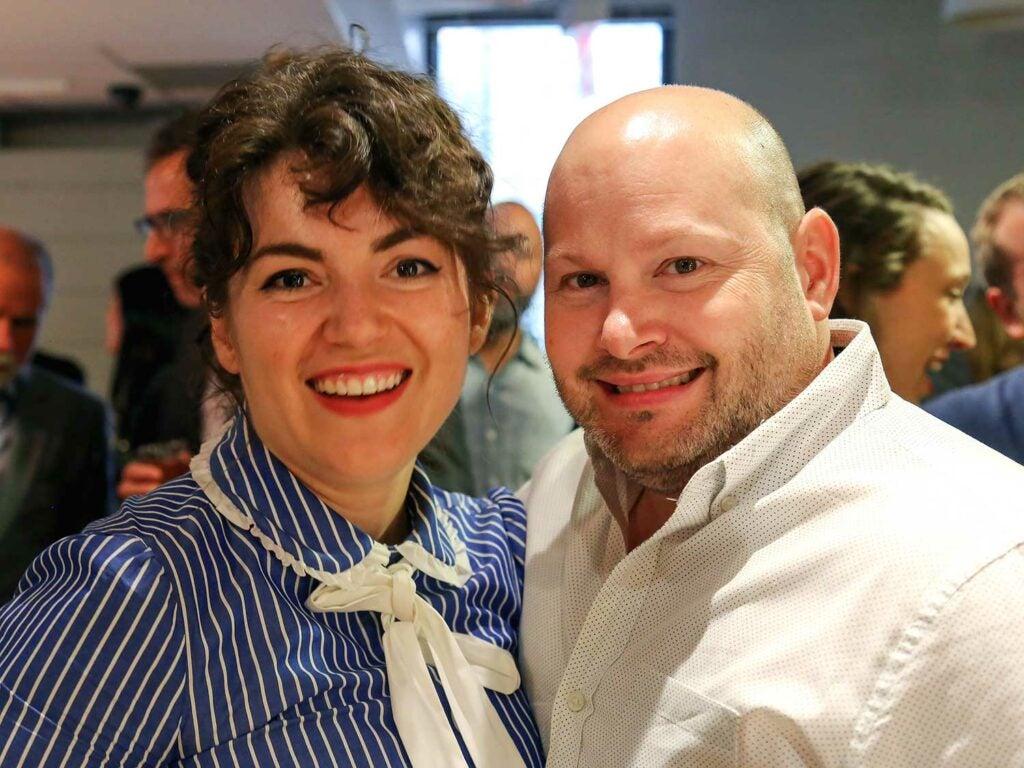 Ellen Bennett and chef Dan Kluger smile for the camera.