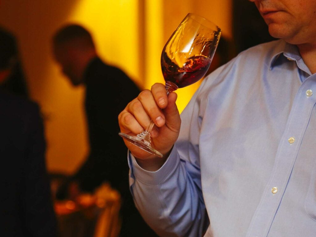 A guest samples a new offering from the Christie's Hospice de Beune collection.