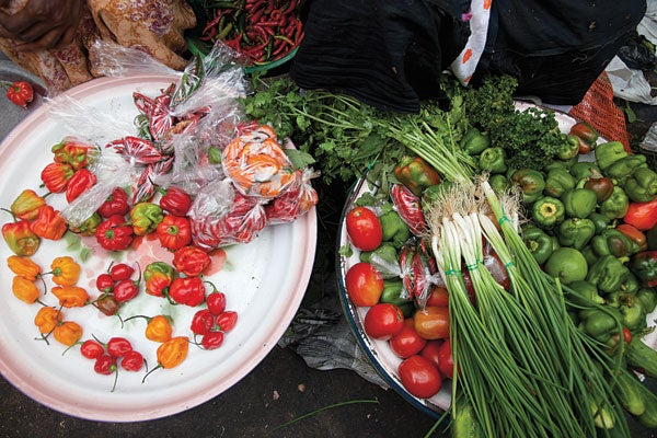 Peppers, scallions, tomatoes, and herbs for sale at Marche Kermel, in Dakar