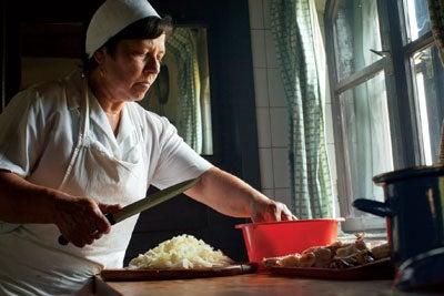 Agnes Elek in the kitchen at Count Kalnoky's estate in Miklosvar