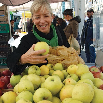Moulton buys seven Golden Delicious apples, her favorite variety for baking.