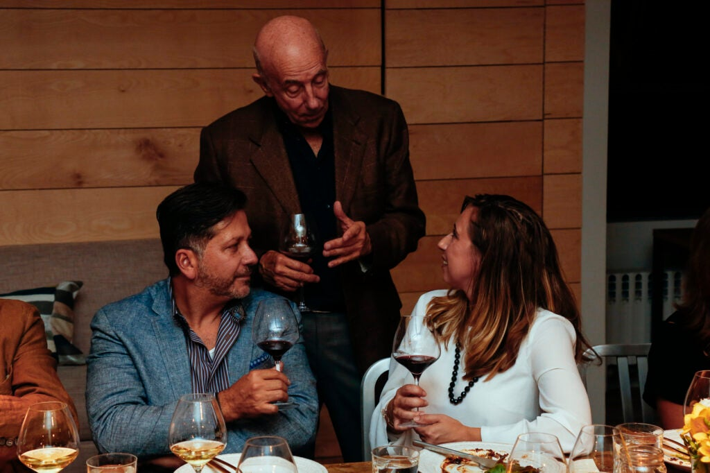 Lynmar Estate's Lynn Fritz chatting with Anthony Giglio and Marie Christina Batich.