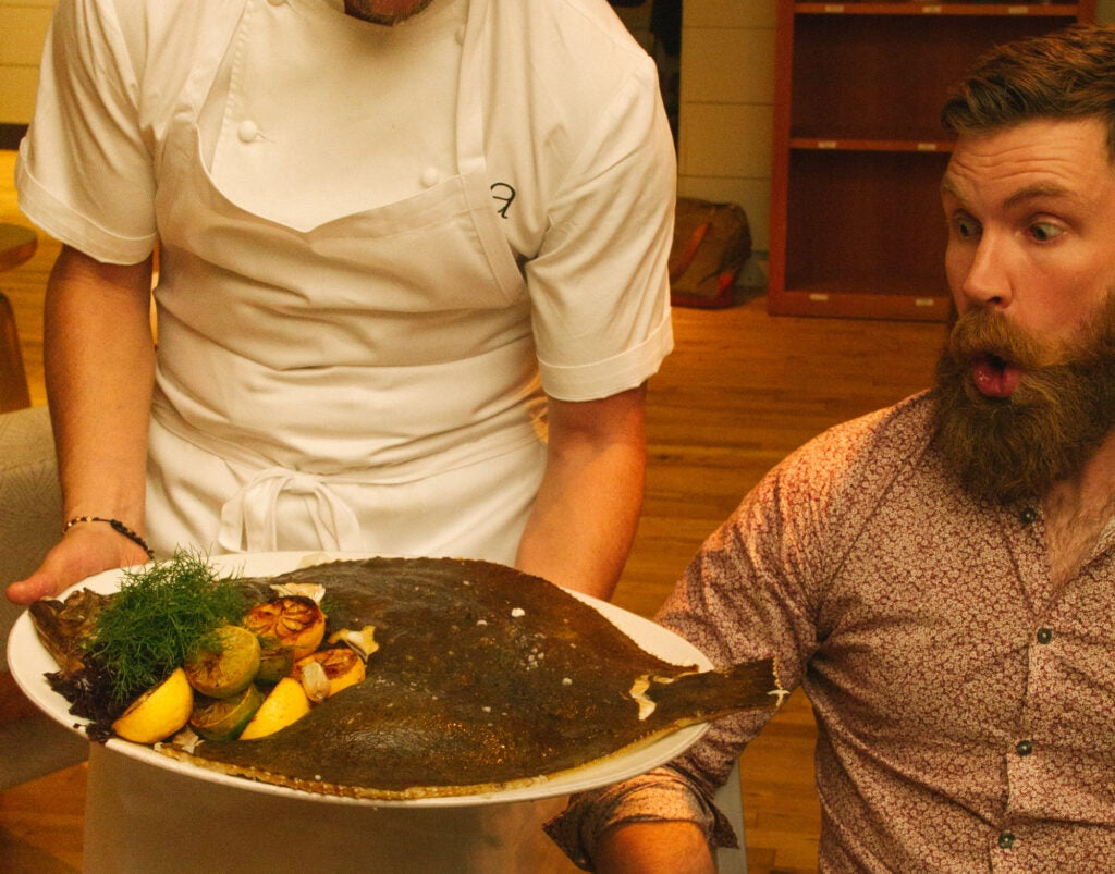 Lafayette Bakery head baker James Belisle reacts to this enormous Atlantic turbot baked in seaweed, capers, and saffron mouselline.