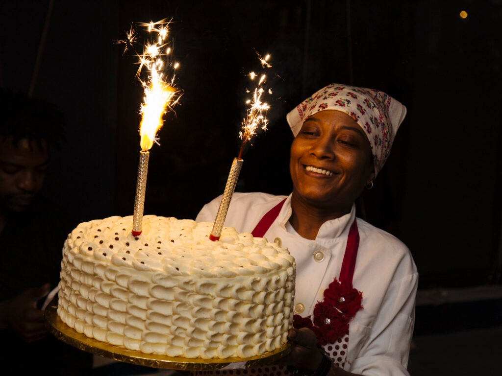 CJ lights sparklers in a rum-drenched red velvet cake