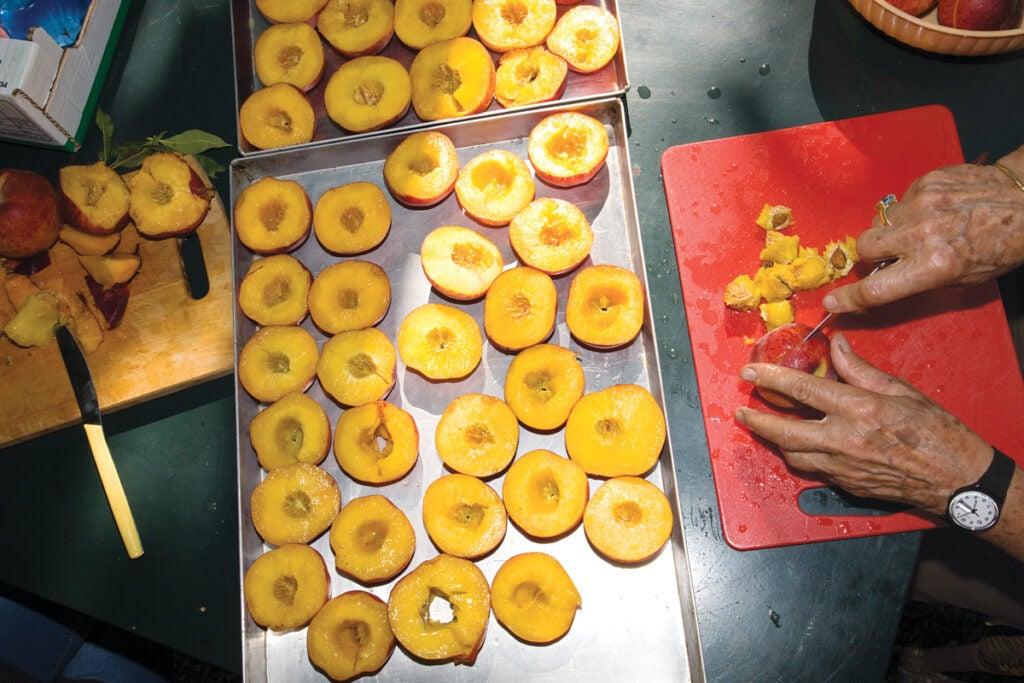 Peaches being prepped for an Amaretti tart