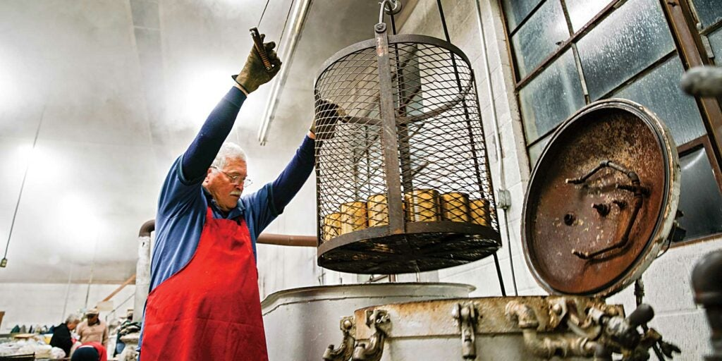 Man preserving at a one of Appalachia's last communal canneries