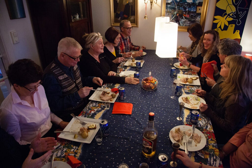 A family eats a holiday meal in Iceland