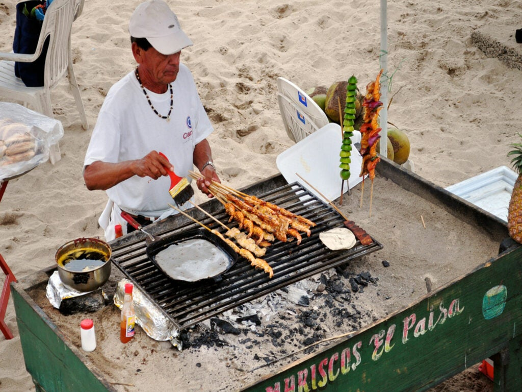 Grilling up a variety of skewers in Puerto Vallarta right on the beach at Playa Los Muertos.