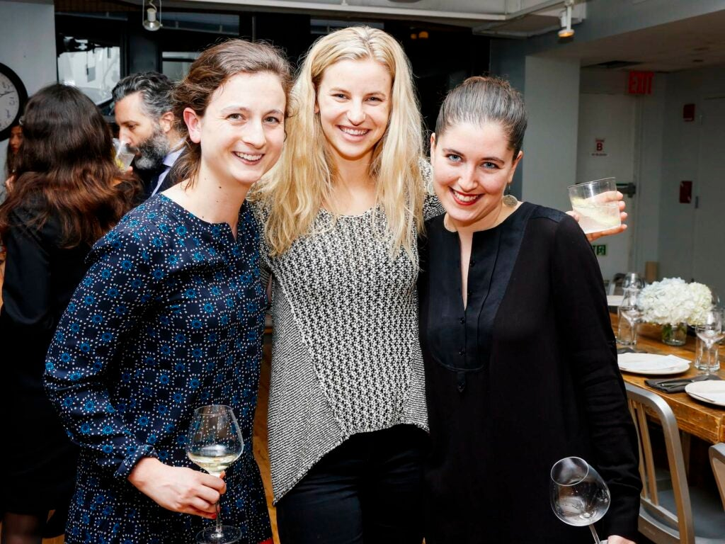 From left, Bonnier Corporation's Molly Battles, Wine Spectator's Jordan McDowell, and NPR's Rose Friedman sip on cocktails and wine before the seated dinner at the SAVEUR Test Kitchen.