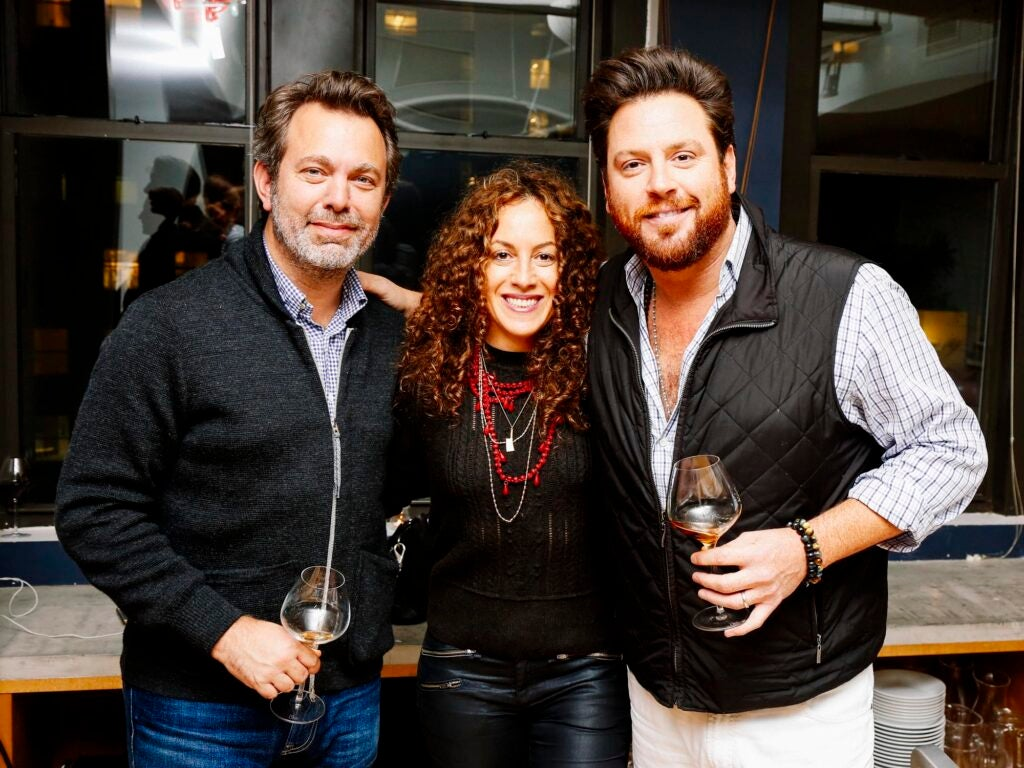 SAVEUR Editor-in-Chief Adam Sachs, My Last Supper photographer Melanie Dunea, and Chef Scott Conant pose for a photo during cocktail hour.