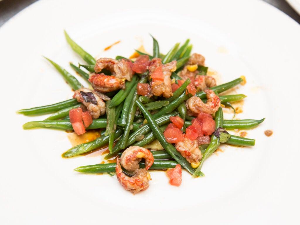 A Haricot Vert salad with Delta crayfish, corn, and opal basil